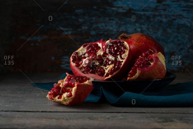 Ripe pomegranates on plate