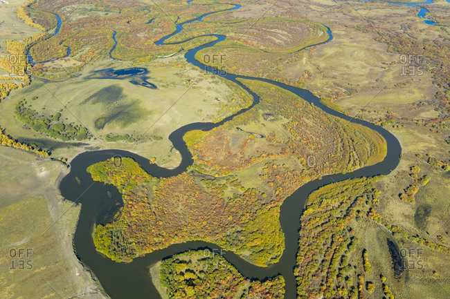 Bending river on plain across the green forest, Inner Mongolia, China, Asia.