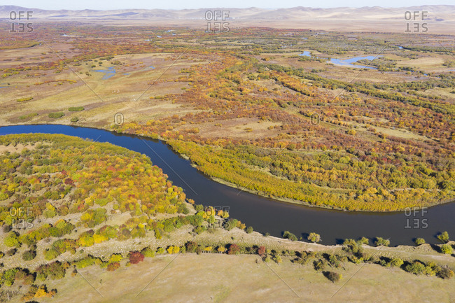River on  plain across the forest, Inner Mongolia, China, Asia.
