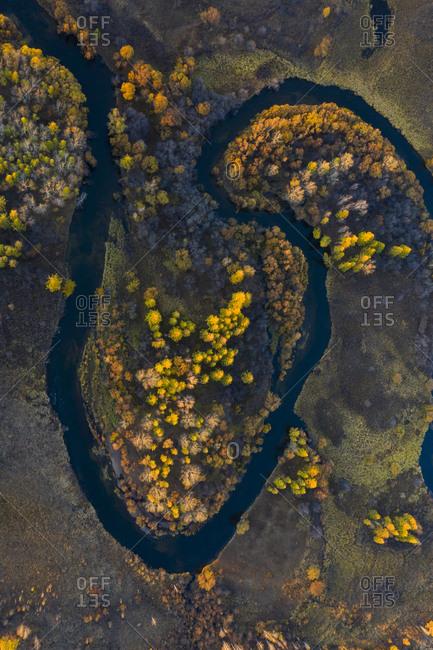 Bending river across plain, path of river like heart shape