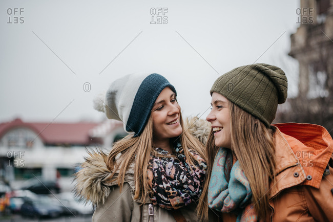 Family moment, two pretty young sisters smiling and enjoying themselves