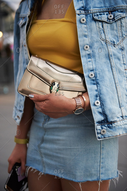 March 09, 2018- Melbourne, Australia: Close up of Bvlgari metallic purse held by fashion show guest, vertical