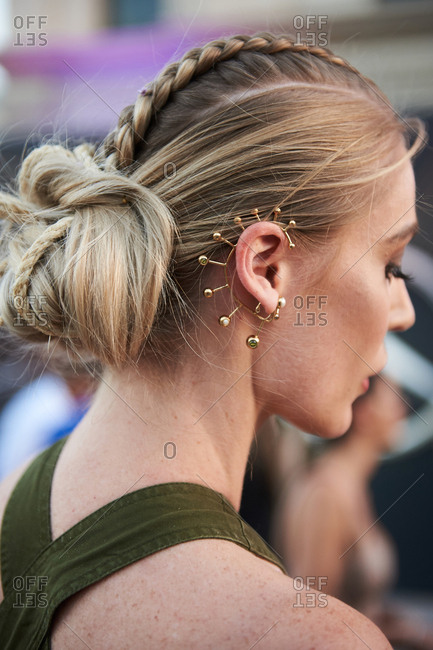 March 09, 2018- Melbourne, Australia: Fashion show guest with braided blonde hair and intricate ear piercing detail