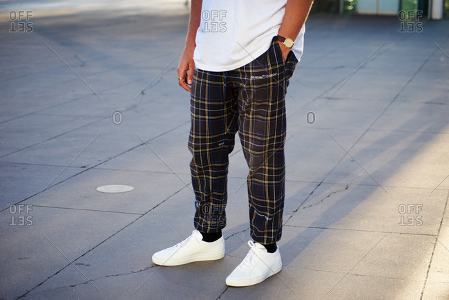 March 09, 2018- Melbourne, Australia: Fashion show guest wearing OFF-WHITE plaid relaxed fit trousers