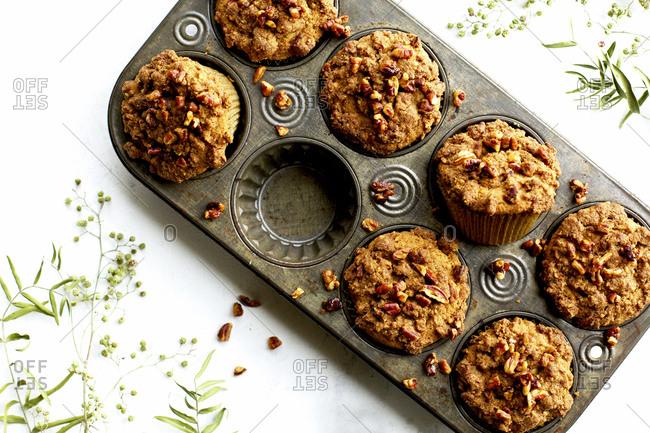 Pecan crumb cake muffins in a baking pan