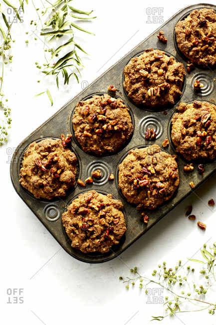 Fresh baked pecan crumb cake muffins in pan