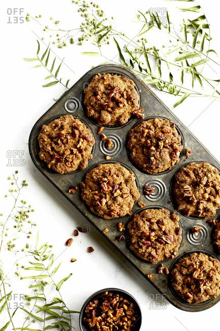 Fresh baked pecan crumb cake muffins in cupcake pan