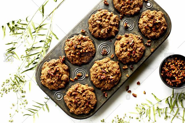 Overhead view of fresh baked pecan crumb cake muffins in cupcake pan