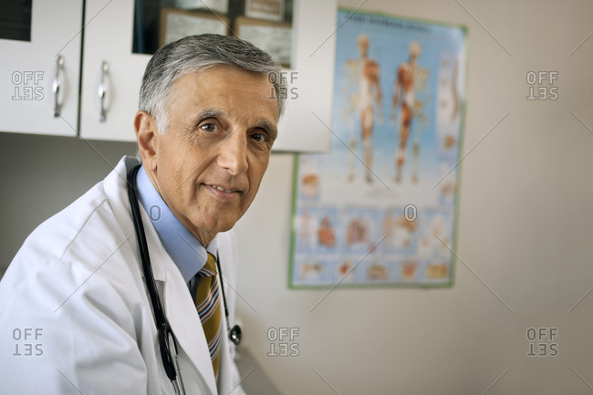 Portrait of a serious senior doctor.
