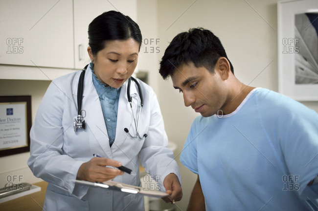 Female doctor consulting with a patient after a medical examination in her office.