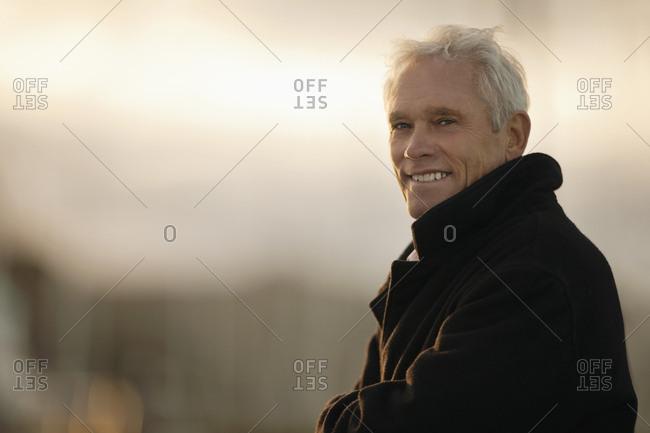 Senior man poses for a portrait.
