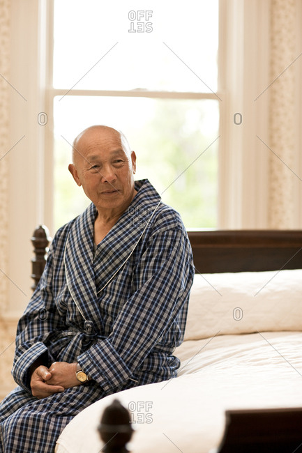Portrait of unwell senior man in his room.