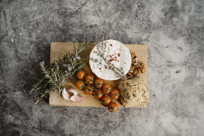 Arrangement of healthy Mediterranean food with bread, tomatoes, cheese and spices