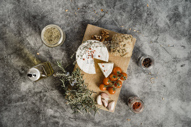Overhead view of cheese plate on marble table