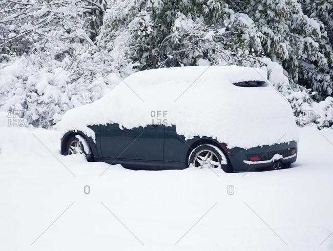 Victoria, British Columbia, Canada: February 11, 2019: Car covered in snow