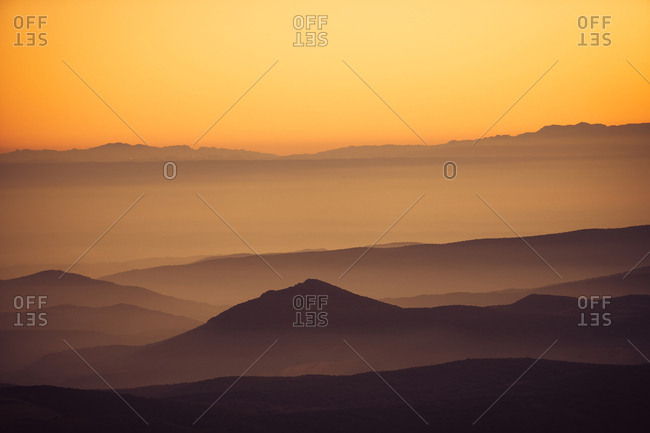 Landscape of golden sunset over mountains