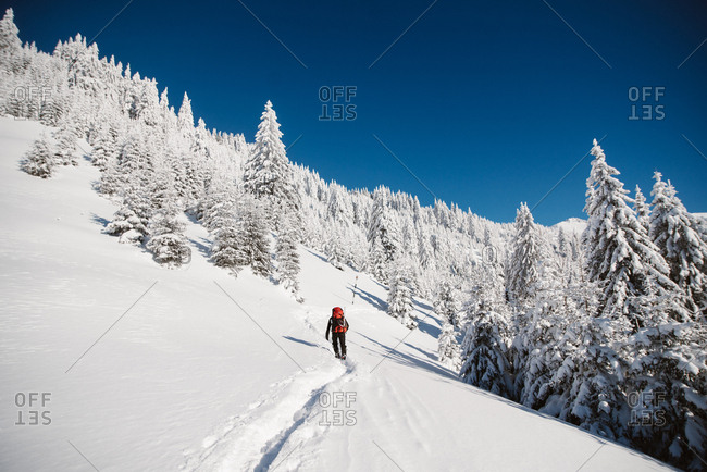 Person hiking on snowy hill