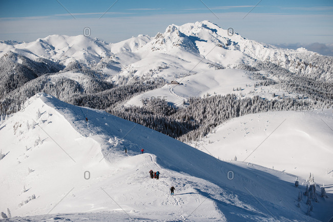 View over group of people hiking on snowy mountain