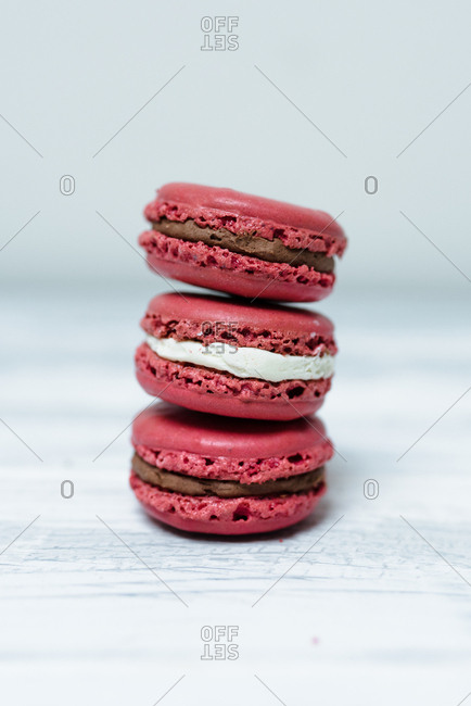 Pink macarons on white background