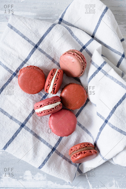 Pastel pink macarons on towel
