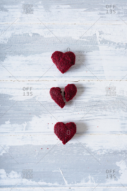 Three heart shaped cookies on white background