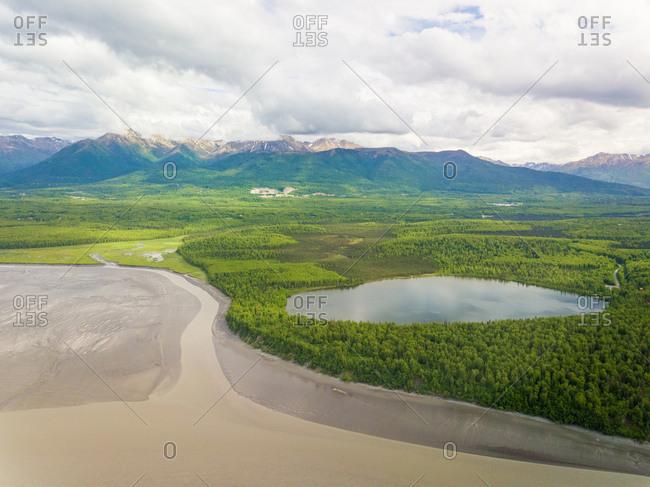 Aerial view of water reservatory near muddy shore, Kachemak bay, Alaska.