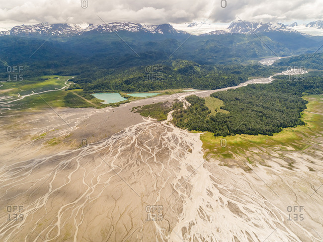 Aerial view of river with abstract pattern near mountain, Kachemak bay, Alaska.