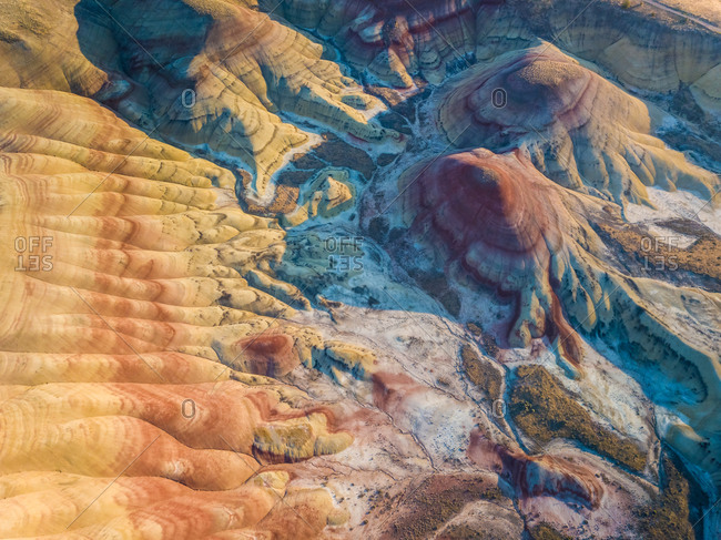 Aerial view of Painted Hills rock formation during the sunset, Oregon, U.S.A.