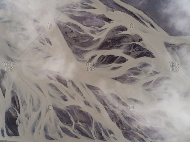 Aerial view above of glacial river on the southern region of Iceland.