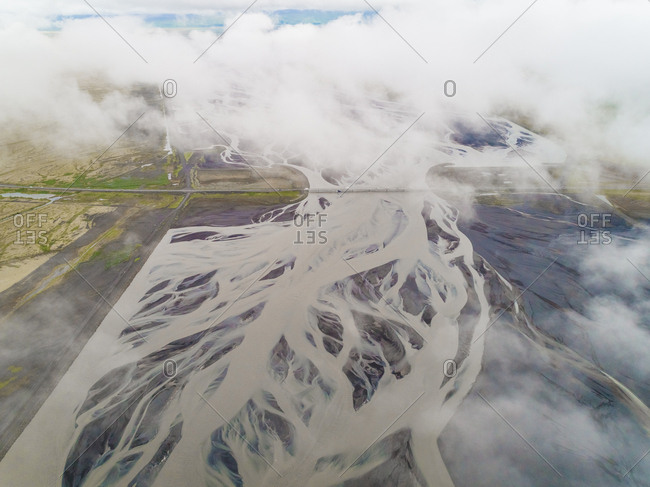 Aerial view of road crossing a glacial river on the southern region of Iceland.