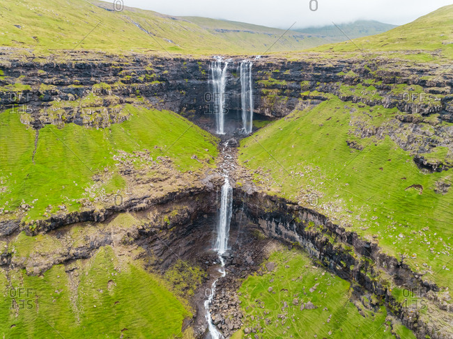 Aerial view of breathtaking Foss� waterfall, Faroe Island.