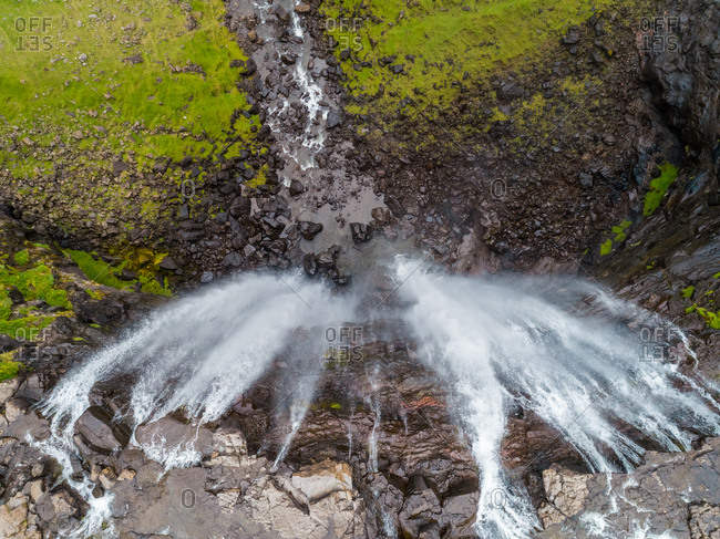 Aerial view above of breathtaking Foss� waterfall, Faroe Island.