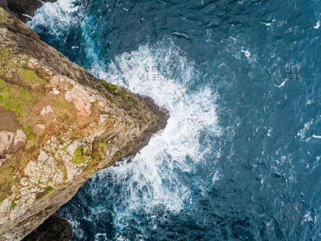 Aerial view above of tourists English Slave cliff on North Atlantic sea, Faroe island.