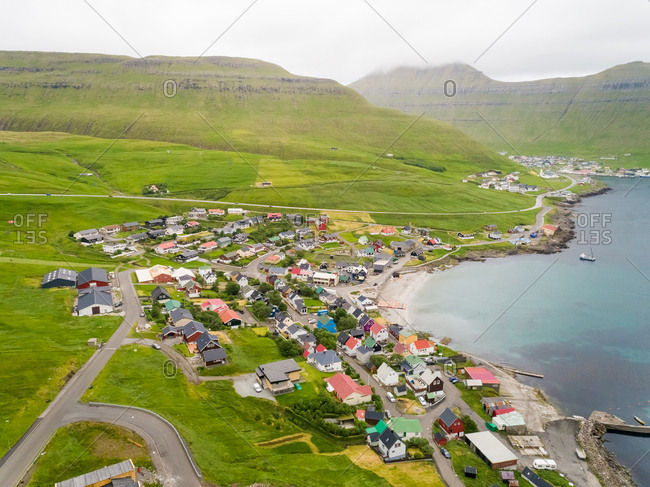 Aerial view of small city on the shore of north Atlantic sea, Faroe island.