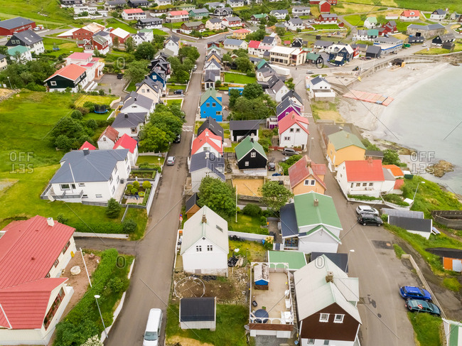 Aerial view of neighborhood with colorful rooftops, Faroe island.