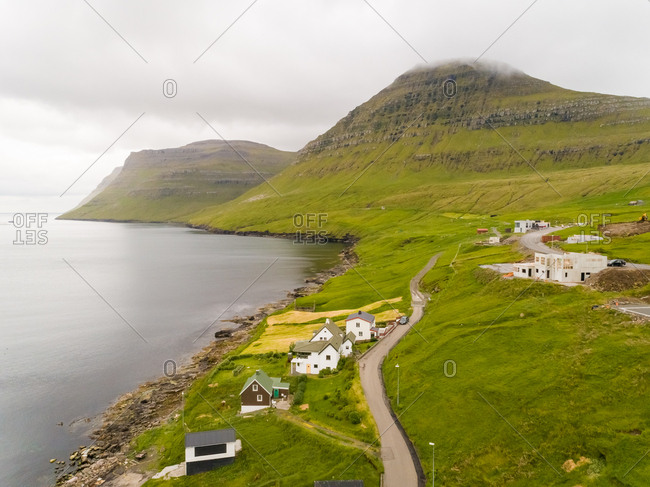 Aerial view of small village on the shore of north Atlantic sea, Faroe island.
