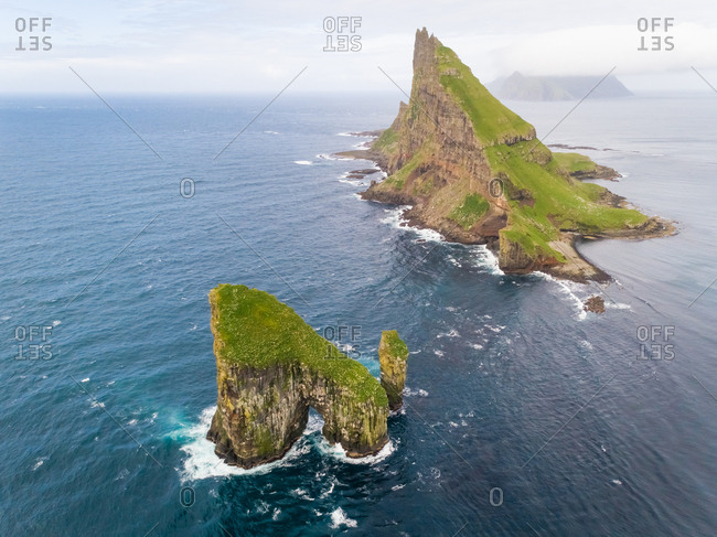 Aerial view of isolated rock formation on the north Atlantic sea, Faroe island.