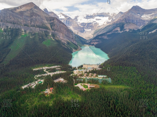 Aerial view of luxury hotel near lake Louise surrounding by tall mountains, Alberta, Canada.