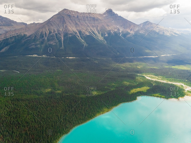 Aerial view of lake Louise near mountain summit, Alberta, Canada.