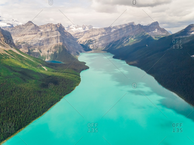 Aerial view of lake Louise surrounding by tall mountains, Alberta, Canada.