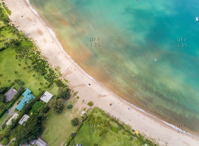 Aerial view above of Waioli Beach park with calm ocean water, Hawaii, U.S.A.