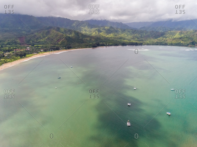 Aerial view faraway of Black Pot Beach surrounding by mountains, Hawaii, U.S.A.