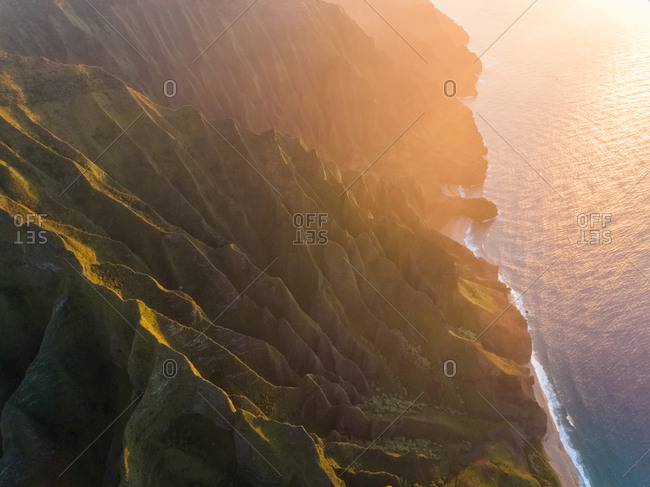 Aerial view of tall mountain formation near the pacific ocean during the sunset, Hawaii, U.S.A.
