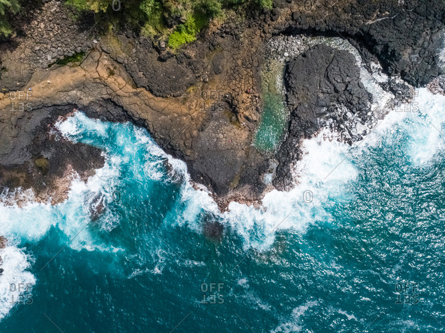 Aerial view of coastal rock formation with an agitated sea, Hawaii.