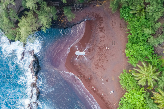 Aerial view of a drone flying over red sand beach, Hawaii, U.S.A.