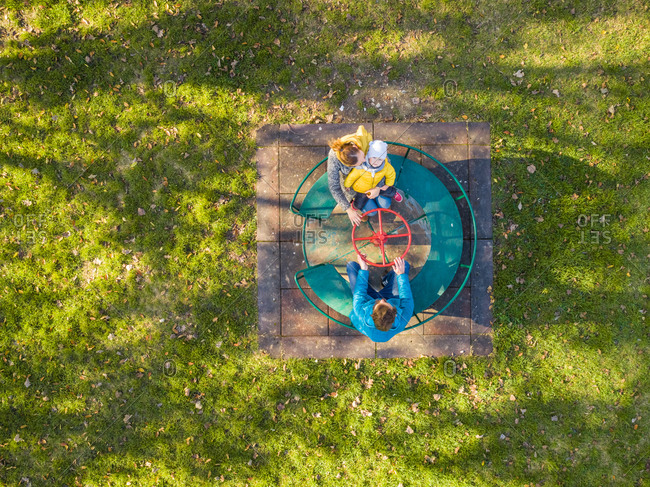 Aerial view of family enjoying day at merry-go-round, Zagreb, Croatia.