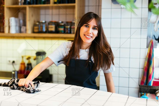 Portrait of a young waitress working in a coffee shop.