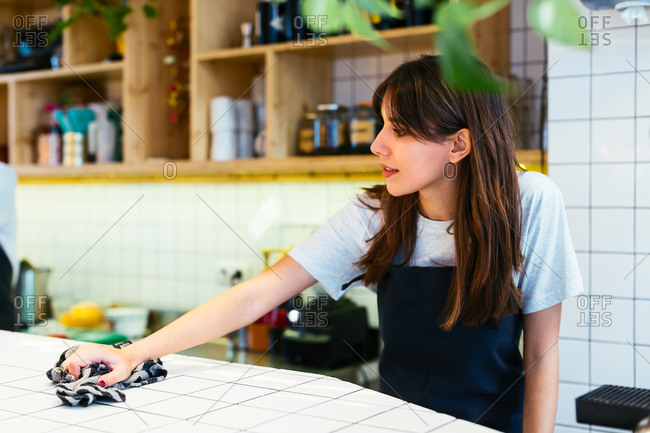 Young waitress working in a coffee shop.