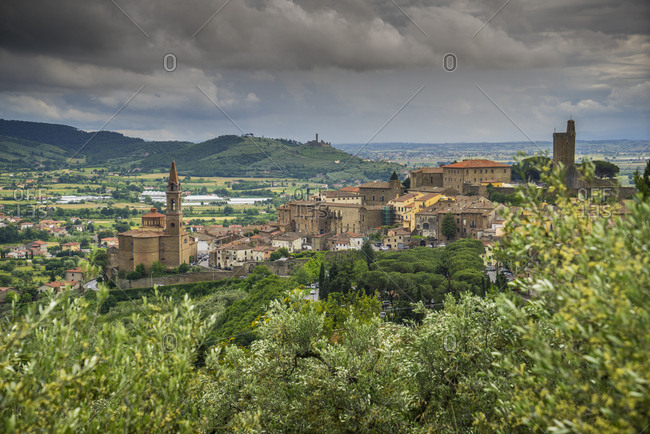 June 2, 2016: Italy, Tuscany, Castiglion Fiorentino . view of the medieval town and in the background the castle of Montecchio Vesponi. On the right of the picture the Val di Chiana tableland, wide valley of very fertile land reclaimed