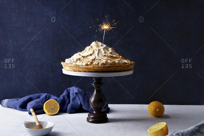 Lemon meringue tart with festive sparkler